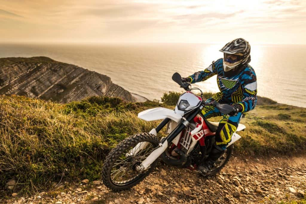 Enduro rider climbing a steep slop