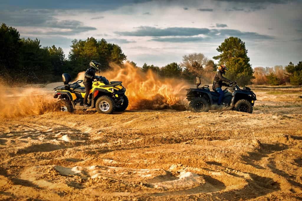 Racing in the sand on a four-wheel drive quad